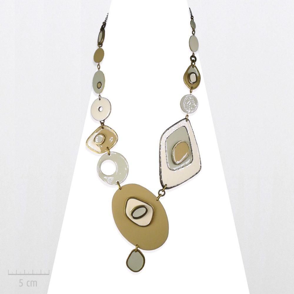 Grand collier moderne représentant les palettes de peinture du surréalisme, de l'artiste Dali.Plastron pastel beige, blanc. Bijou haut de gamme, Zor design contemporain