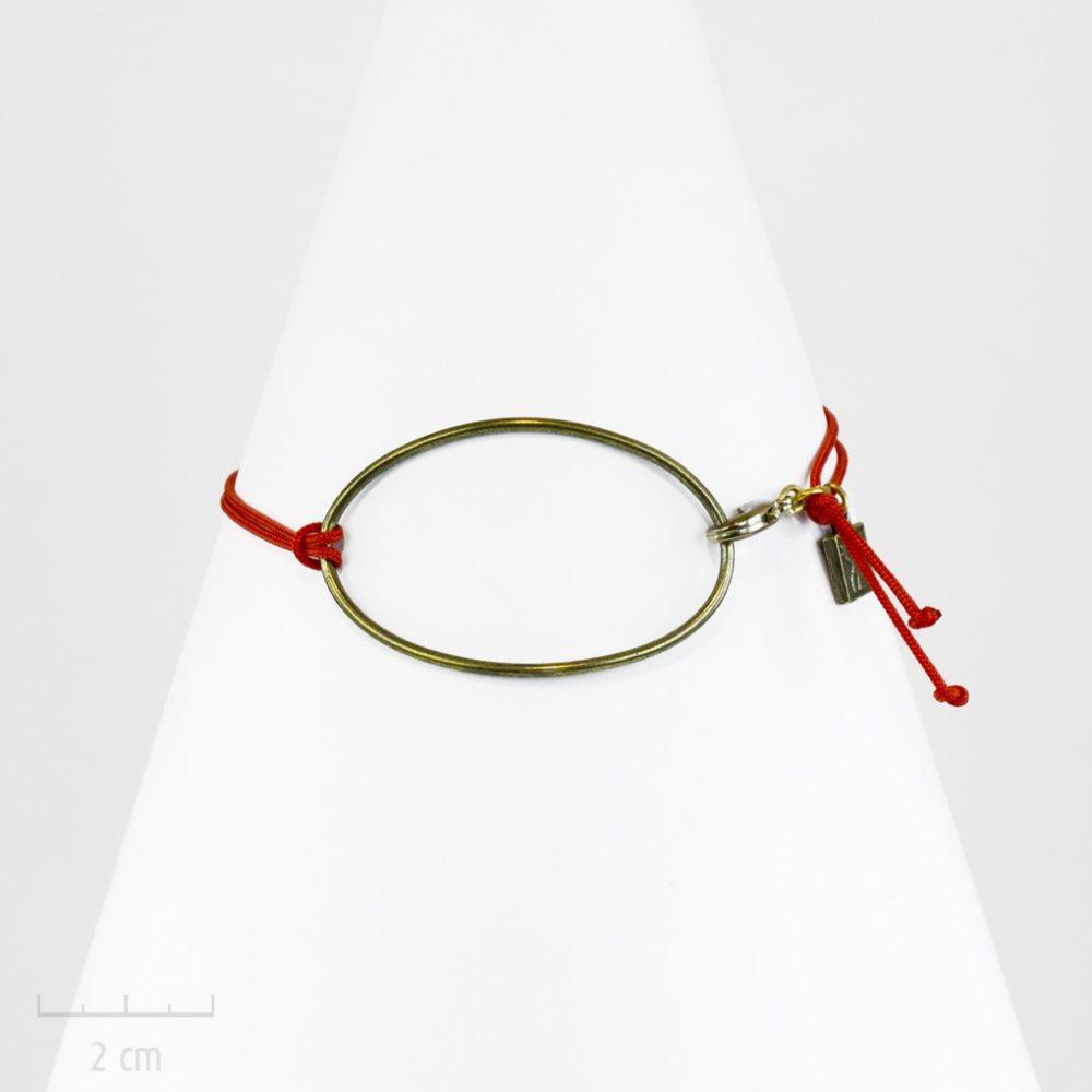 Bracelet HOMME, bronze et cordon rouge, style sobre, élégant et ovale. Moderne et classique, symbole de la terre, l'oeil minimaliste. Création Zor