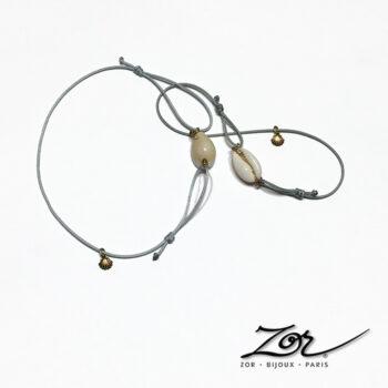 Bracelet Homme marin à cordon réglable. Coquillage cauri d'Afrique: porcelaine nacre de mer pour un été nature. Zor création Paris